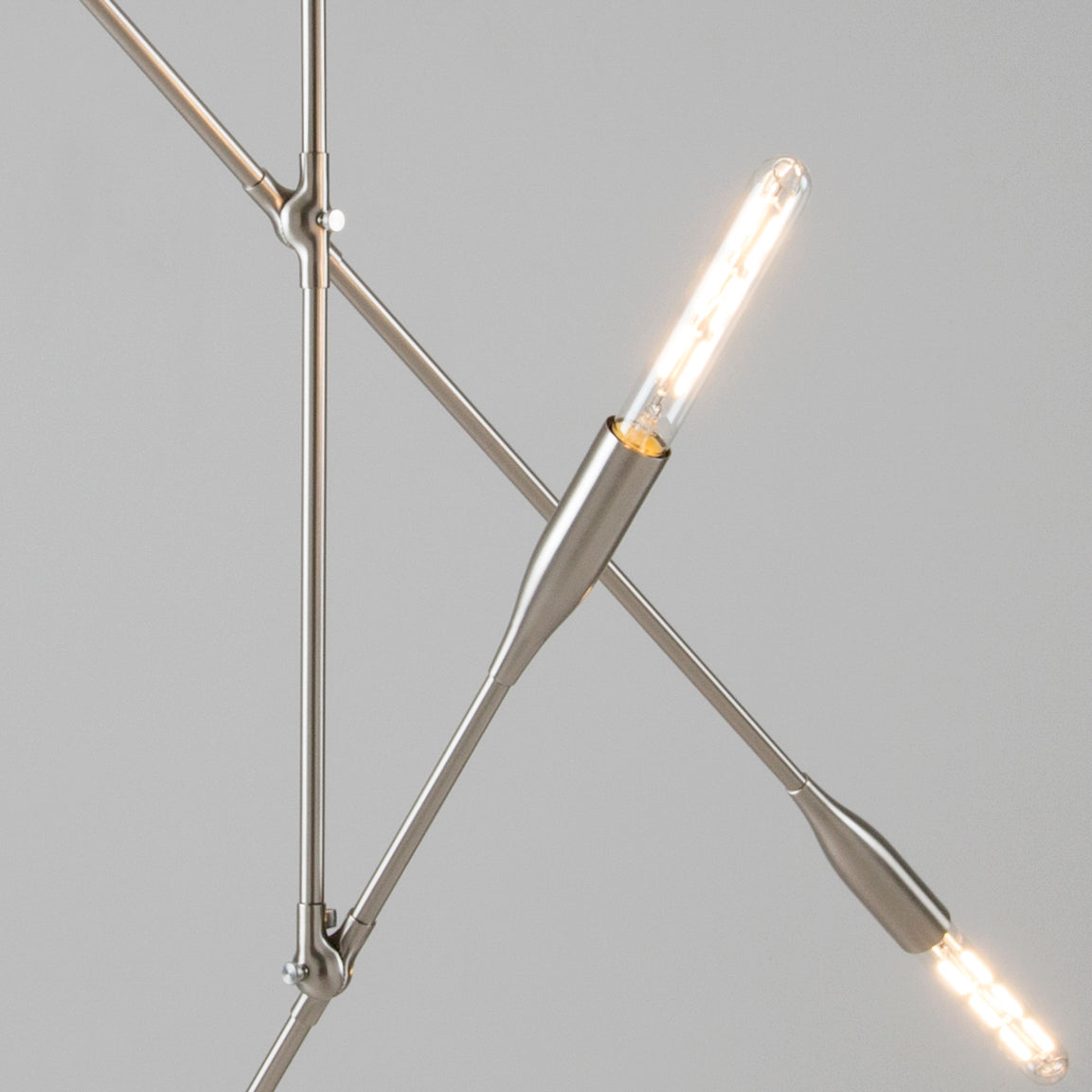 Sorenthia 2-Arm Light in Brushed Nickel Close Up View of crossing lighting arms by Studio DUNN