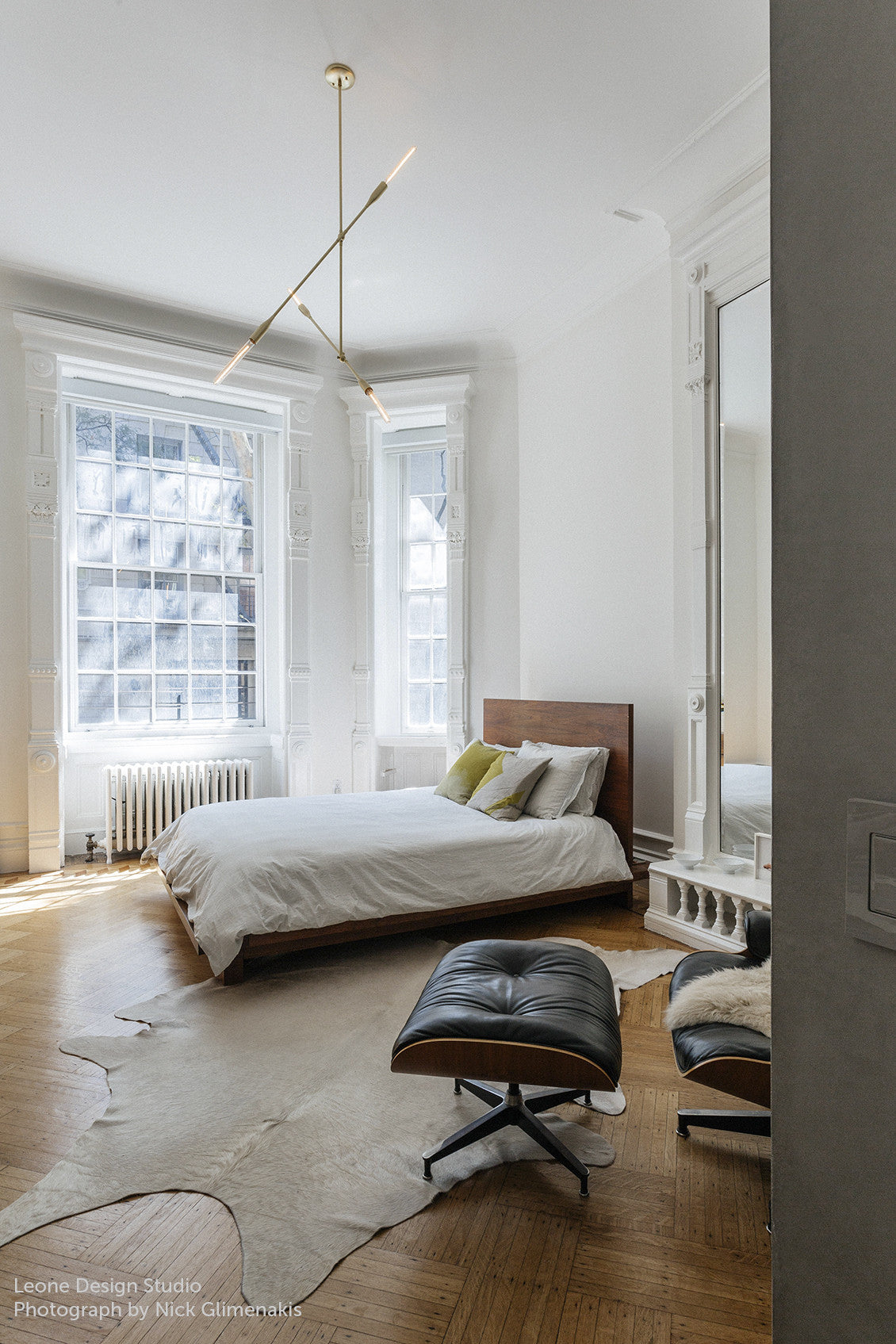 Studio DUNN's Sorenthia 2-Arm Light in Brushed Brass installed over a bedroom in a Brooklyn brownstone designed by Leone Design and photographed by Nick Glimenakis