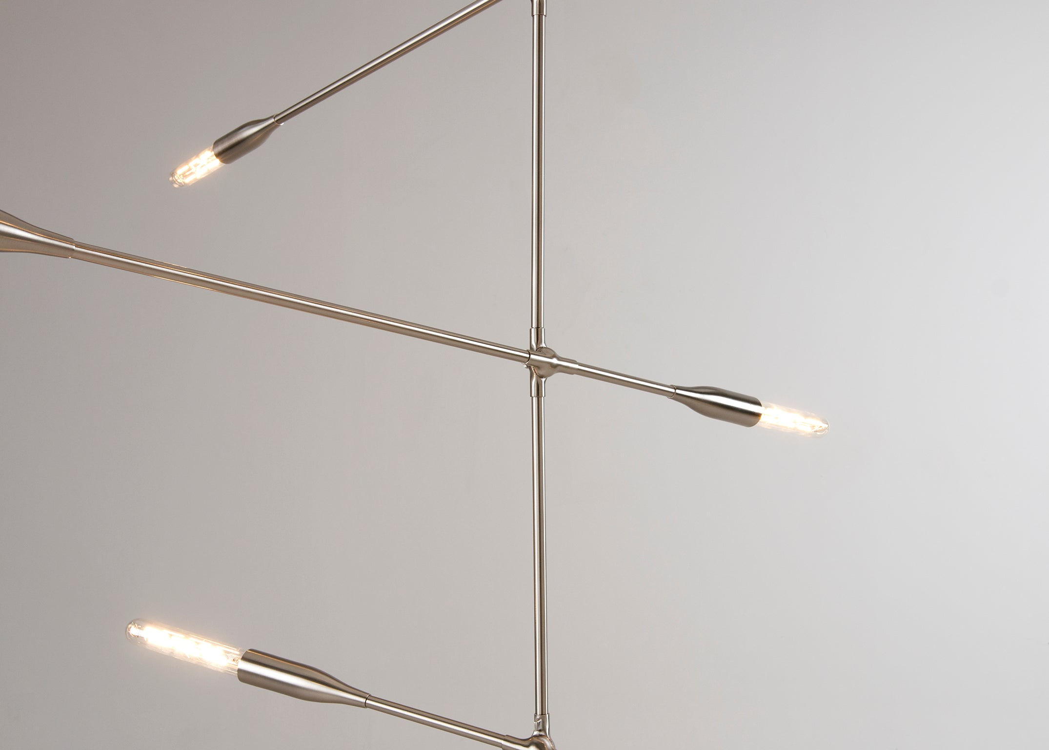 Sorenthia 3-Arm linear modern light in Brushed Nickel by Studio DUNN Close Up on grey background