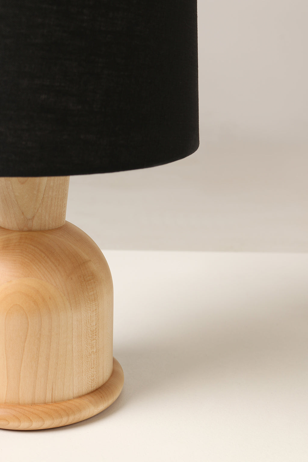 Close up side view of Beacon Table Lamp with Black Linen Shade and Maple Base by Studio DUNN