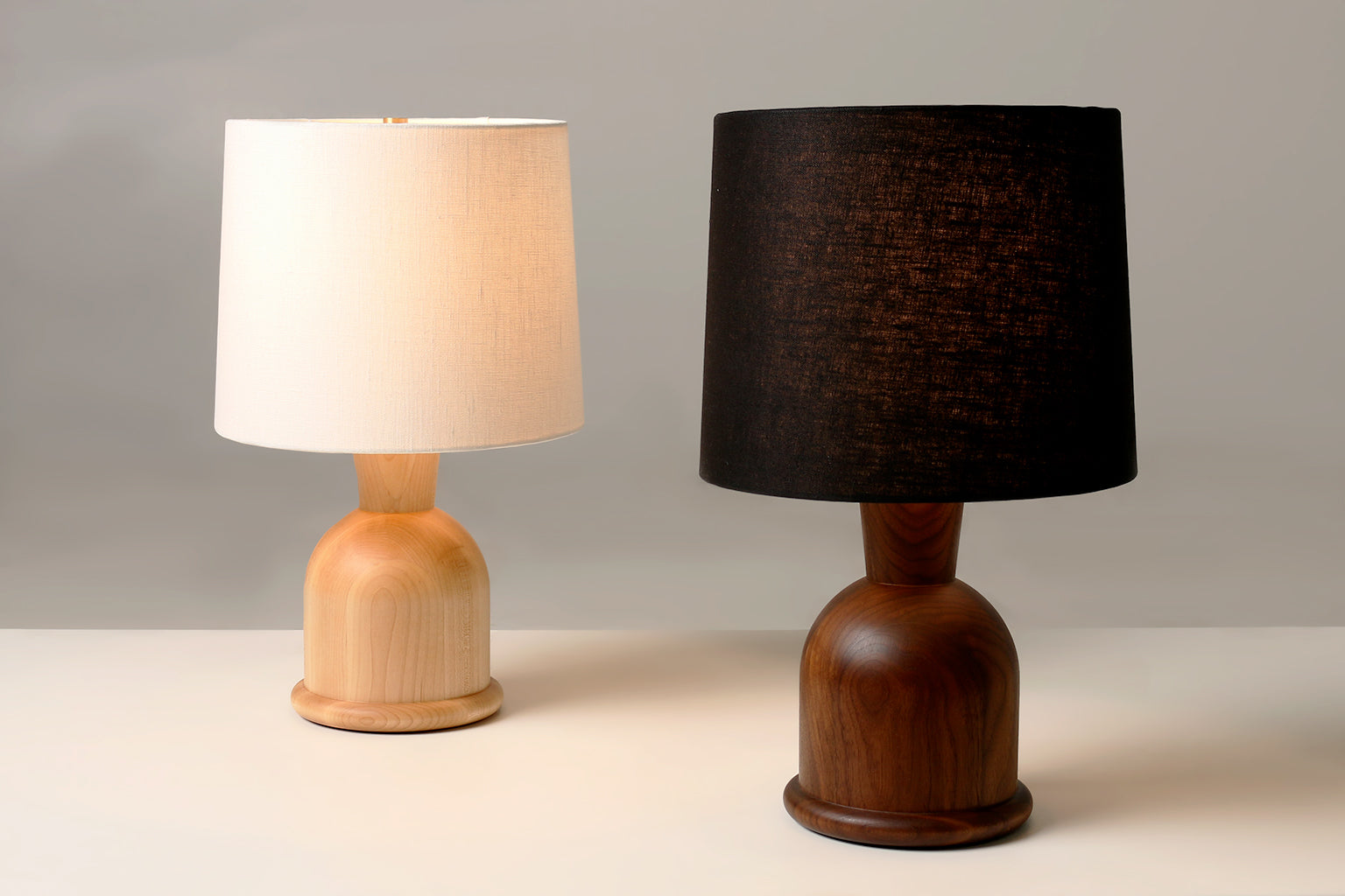 "Two Beacon 18"" Table Lamps with Cream Linen and Maple and Black Linen and Walnut"