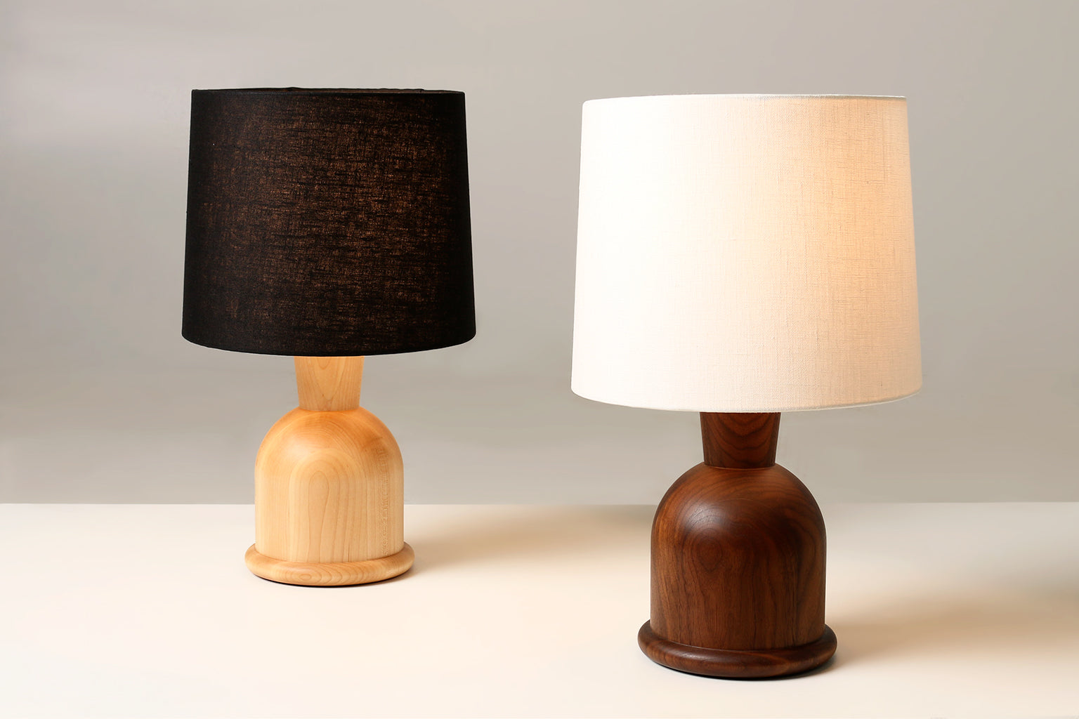 "Two Beacon 18"" Table Lamps with Black Linen and Maple and Cream Linen and Walnut"