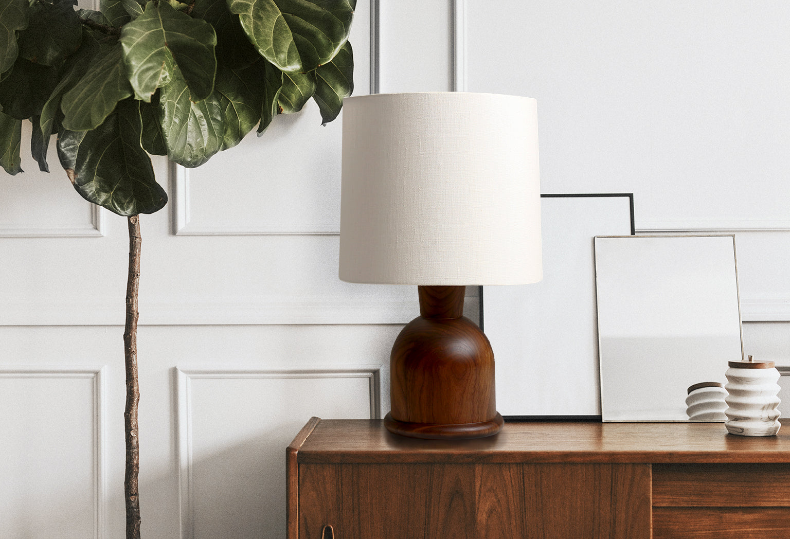 Beacon Table Lamp by Studio DUNN with cream linen shade and walnut base on credenza with house plant