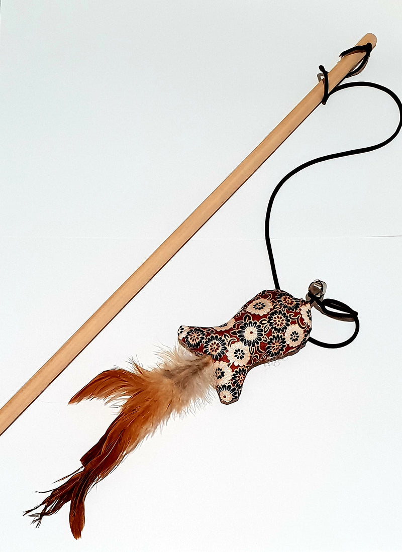 Wooden fishing pole cat toy.