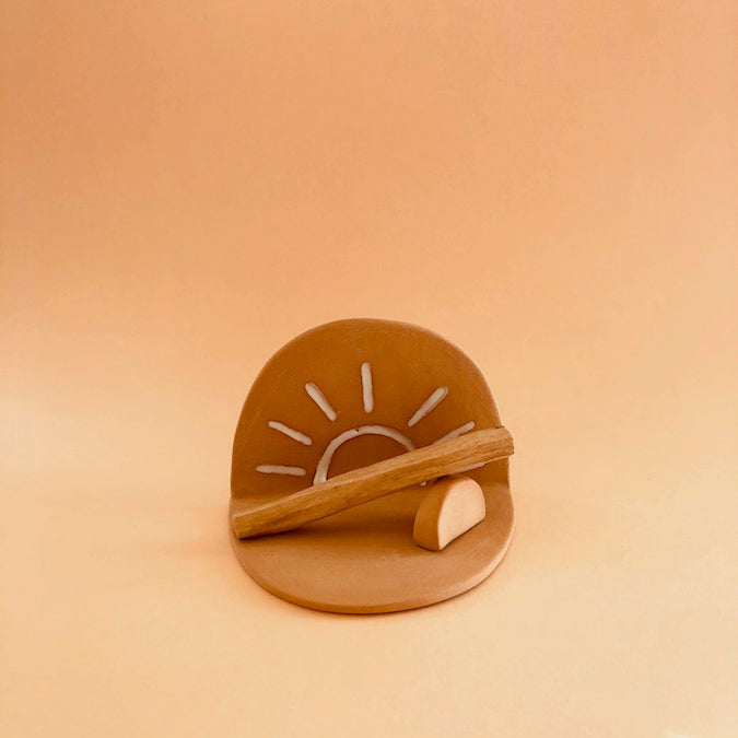 SUN WORSHIPPER PALO SANTO INCENSE HOLDER WITH ARCH STAND