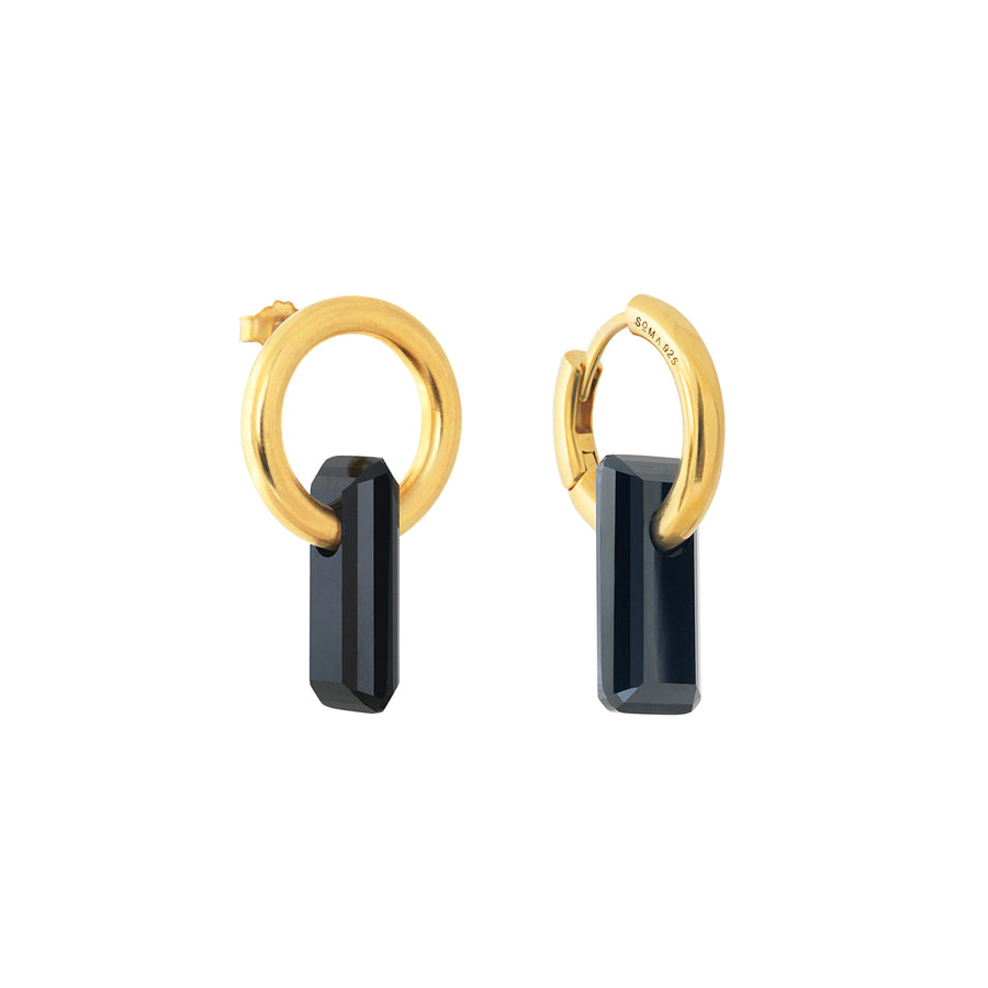 asymmetrical pair of earrings, hoops and stud, gold, big black stone, white background.