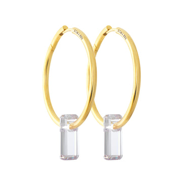 golden earrings, large hoops, stone trough hoops, white background.
