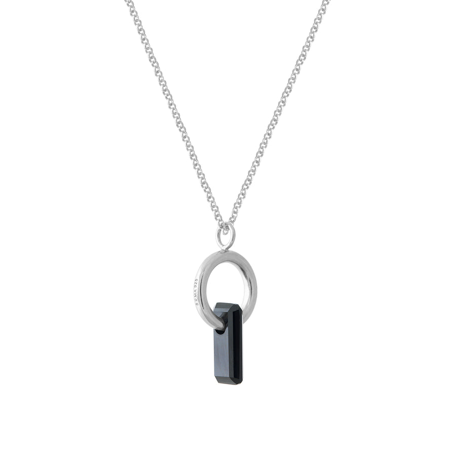 pendant, silver chain, silver ring, rodium covered, large black stone, stone trough hoop, white background.