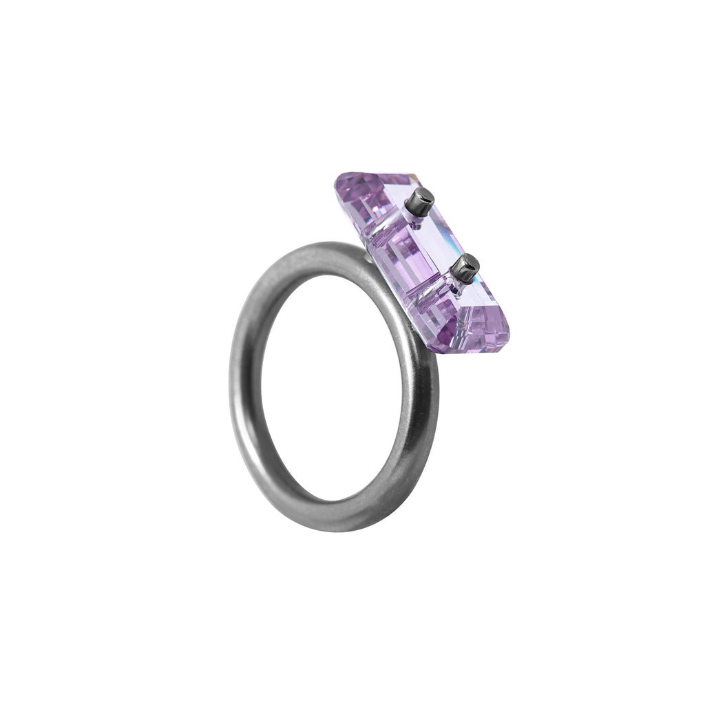 ring, trough stone, rodium covered silver, big lilac eco stone, white background.