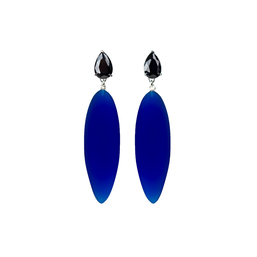 transparent blue rubber, large earrings , drop shaped black stone, white background.