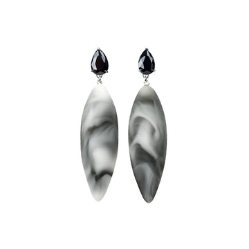 marmor pattern, rubber, large earrings , drop shape black stone, white background.