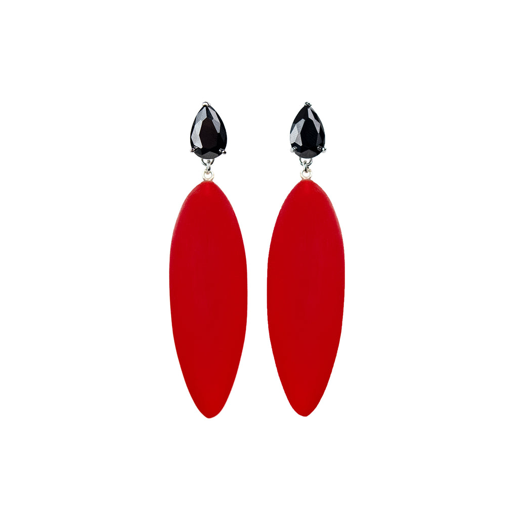 bright red rubber, large earrings , tear shaped black stone, white background.
