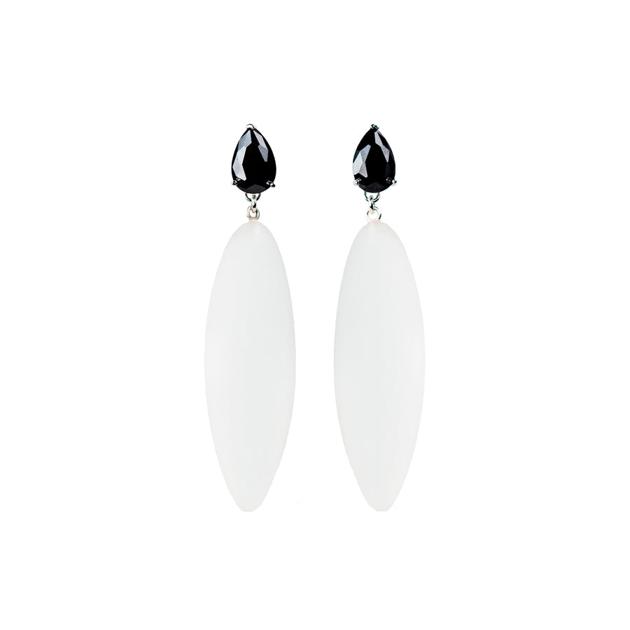 transparent rubber, large earrings , drop shaped black stone, white background.