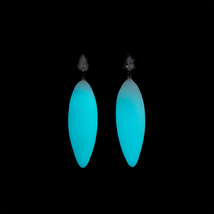 earrings, glowing in darkness, blue glow.