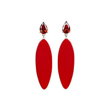 bright red rubber, large earrings , tear shaped red stone, white background.