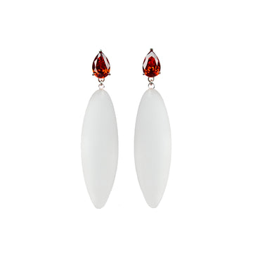 transparent rubber, large earrings , tear shaped red stone, white background.