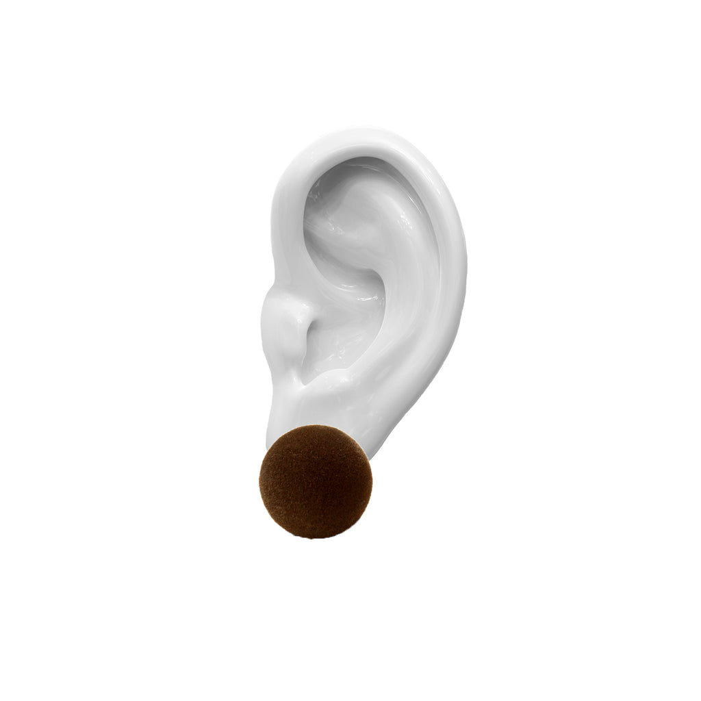 porcelain ear,  brown velvet earring, on top, white background.