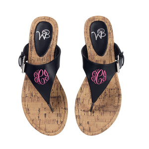 Black monogram flip flop sandals front view