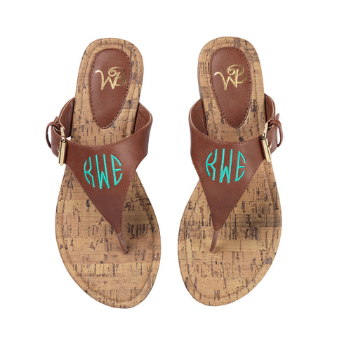 Front view of the brown flip flop monogram sandals