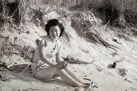 Black and white photo of beautiful Japanese woman sitting on the beach Helen Hisae M Hisae