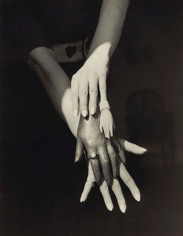 Black and white surrealist photo by Claude Cahun of various sizes of white and black hands layered on top of eachother
