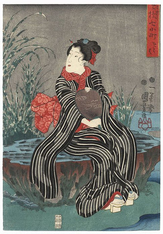 Japanese woodblock print of woman in black and white striped kimonoby Kuniyoshi