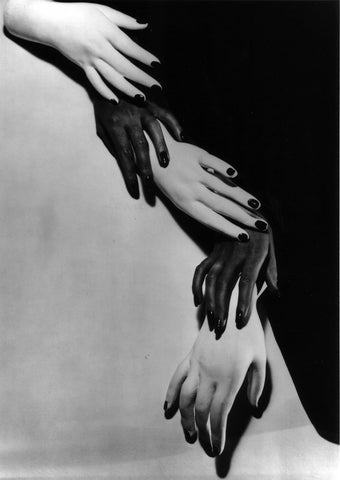 Horst P Horst black and white surrealist photo of overlapping and twisting black and white hands Newyork 1941.