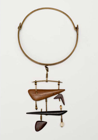 Vivianna Torun Bülow-Hübe brass necklace with hanging pendants made out of various woods and ivory
