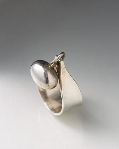 Sterling Silver Ring designed by Vivianna Torun Bülow-Hübe with a bobble on the top against a grey background