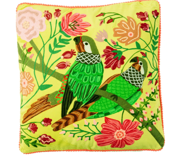 Embroidered green parrots on lime velvet cushion