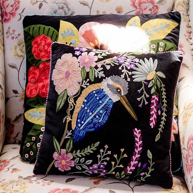 Embroidered kingfisher on velvet cushion