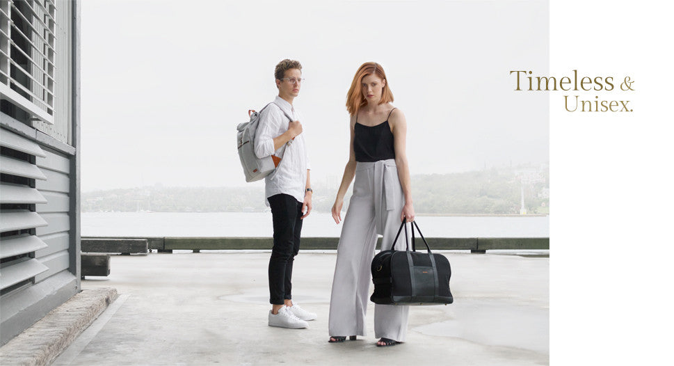 Man with Grey Backpack and woman with Black Weekender