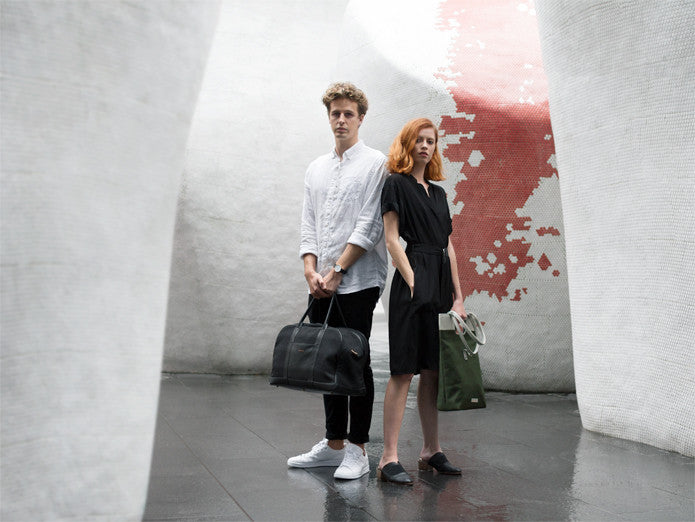 Man and woman standing wearing Von-Röutte bags