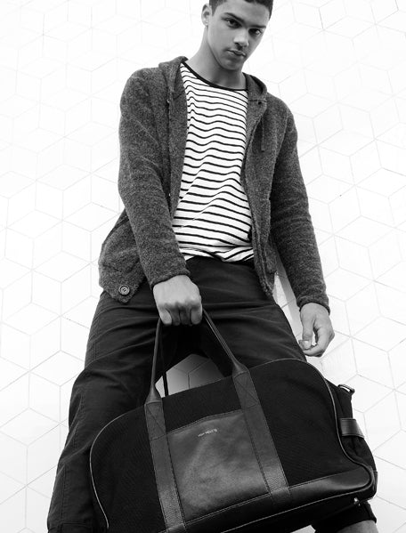 Black and White photo - Guy Holding the Von-Routte Weekender Bag