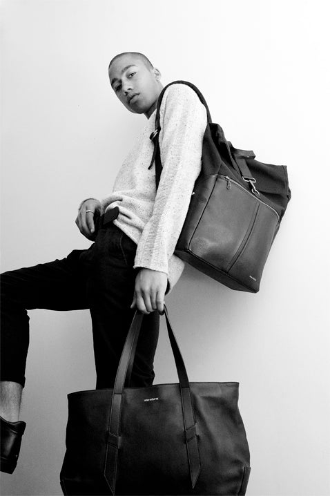 Black and white photo of guy wearing two Von-Routte Bags