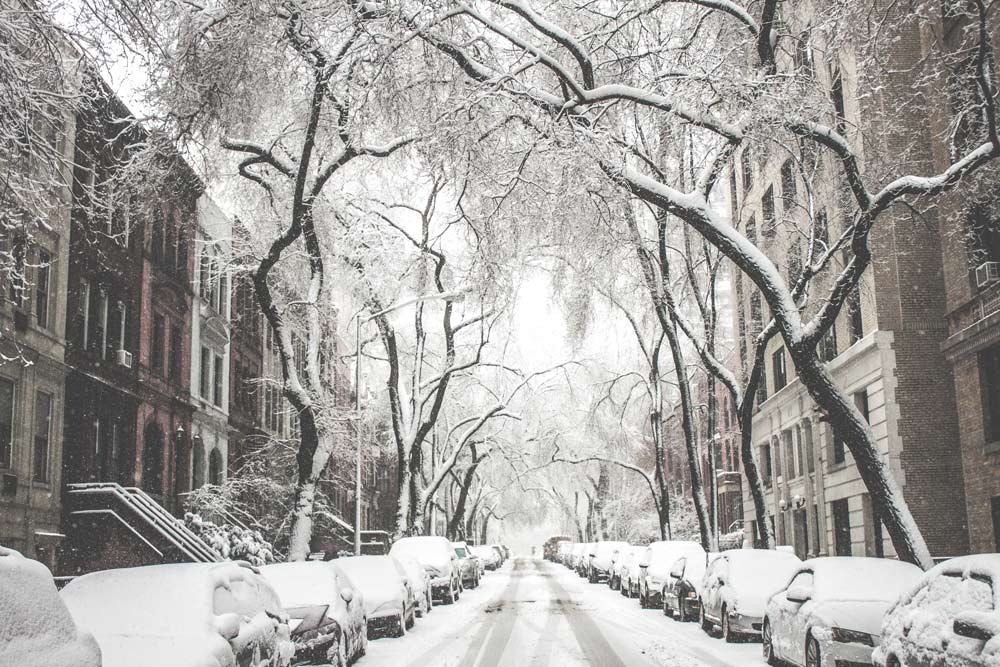 New York during winter. Street and parked cars covered in snow.