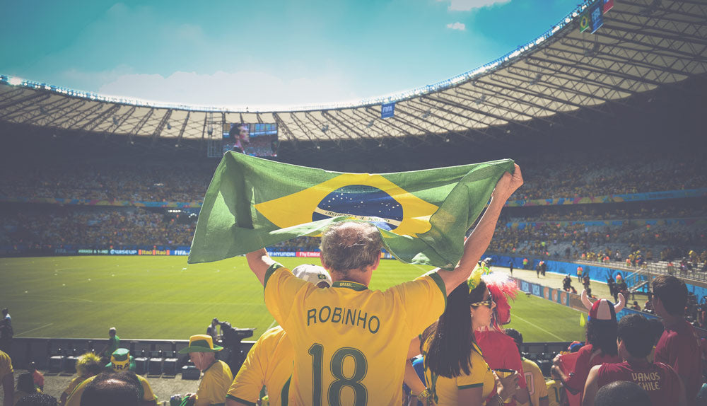 People cheering at Brazilian soccer game at Maracana stadium