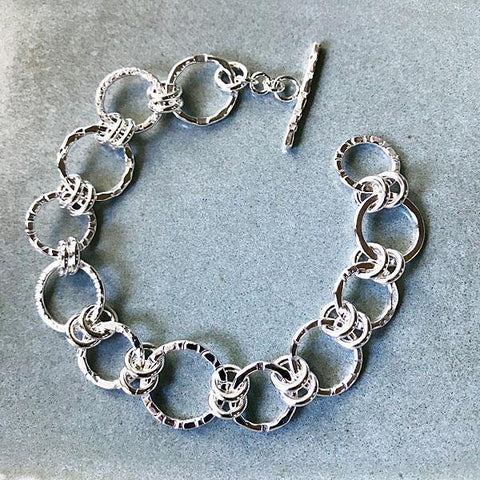 Sterling silver bracelet, textures will vary.