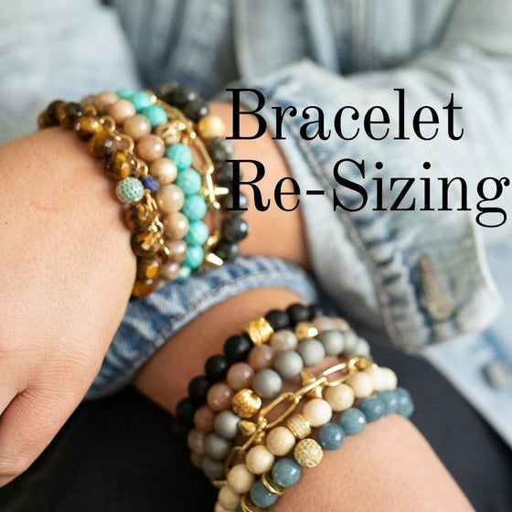 A woman wearing a jean jacket and denim pants with beaded bracelets by Meghan Bo Designs.