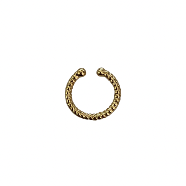A thin small braided gold ear cuff lays on a flat white surface made by Meghan Bo Designs.