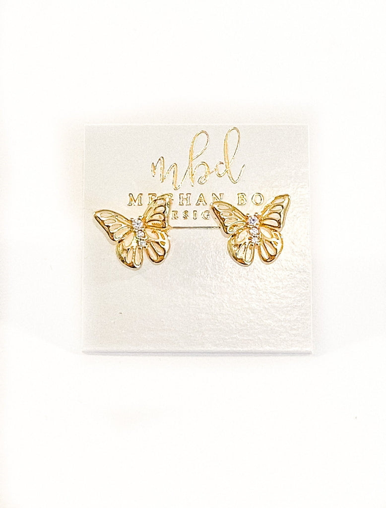 Meghan Bo Designs gold butterfly studs with 3 small cubic zirconias.