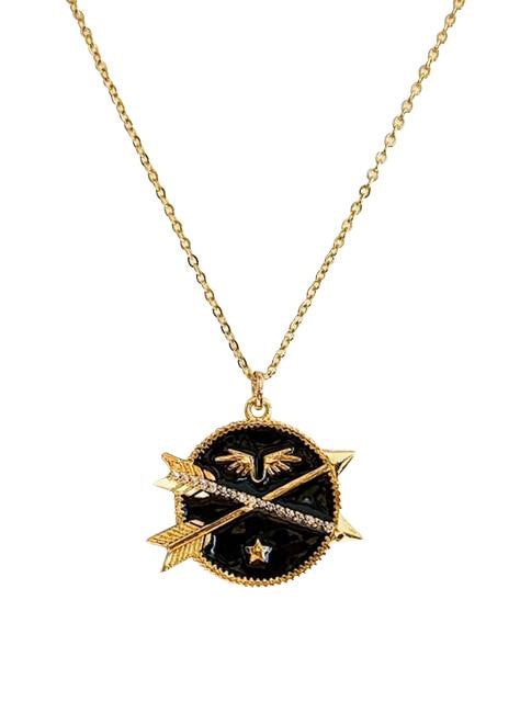 A black enamel coin necklace wit two crossing arrows, a star and wings on a heavy gold overlay chain by Meghan Bo Designs.