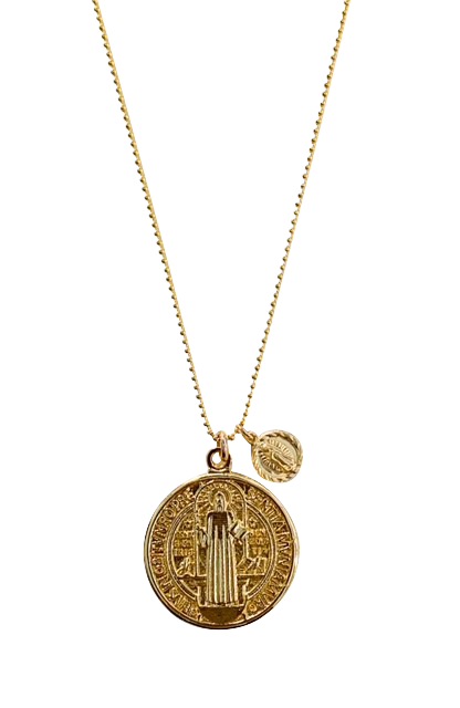 Meghan Bo Designs Faith Necklace is a double coin necklace made with all gold fill materials and has a pendant with Saint Benedict and Our Lady of Guadalupe.