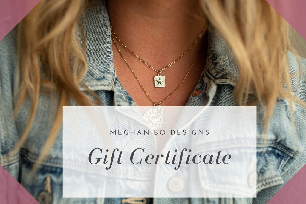 A woman with blonde hair is wearing layered necklaces with a star made by Meghan Bo Designs.
