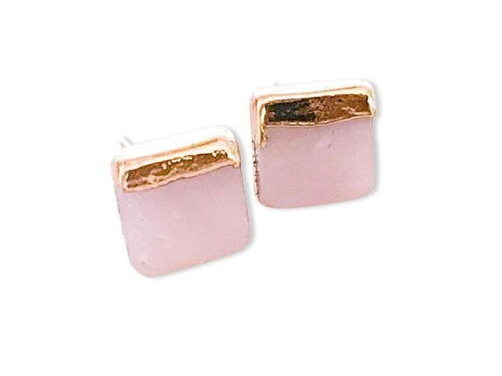 Pearl square stud earrings dipped in gold on one side of the square.