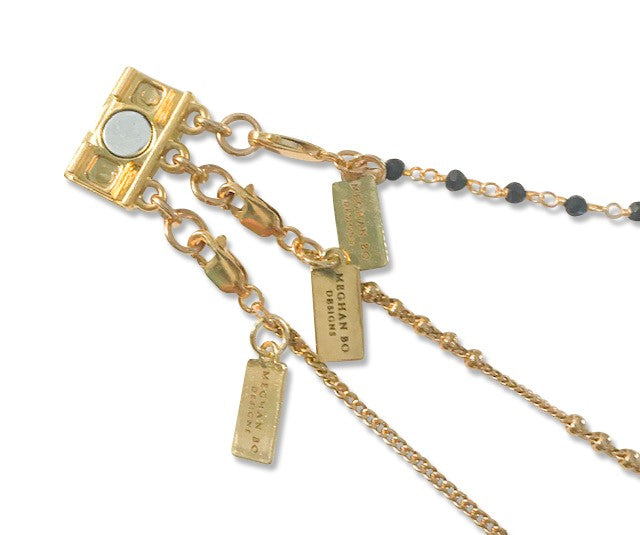 A magnetic clasp with three attachments for layering your necklace so it doesn't get tangled, made by Meghan Bo Designs.