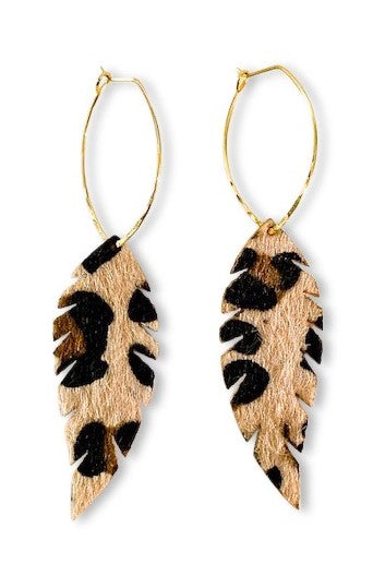 Leopard faux fur feather earrings hang from a gold geometric earring wire made by Meghan Bo Designs.