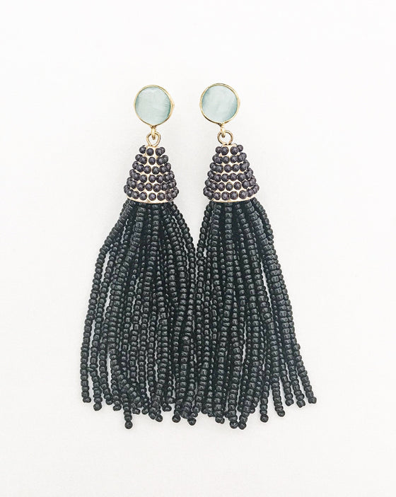 Black beaded tassel earrings with gold and an aquamarine blue post earring made by Meghan Bo Designs.