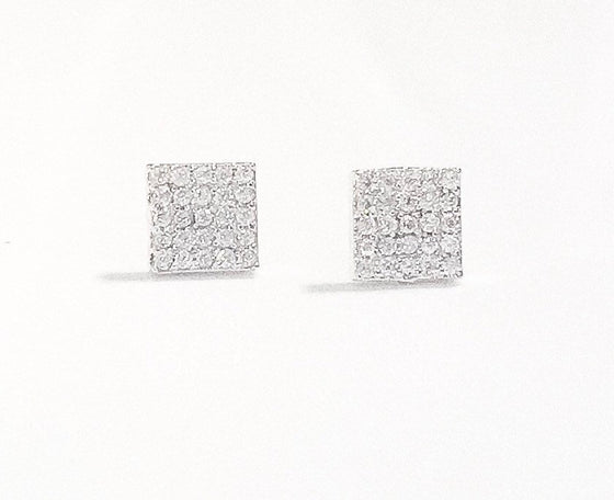 Two small square stud cubic zircona earrings lay on a white background made by Meghan Bo Designs.