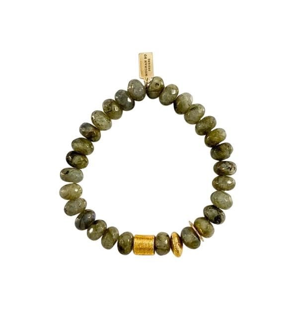 A green labradorite beaded bracelet with gold accent beads made by Meghan BO Designs lays flat on a white surface.